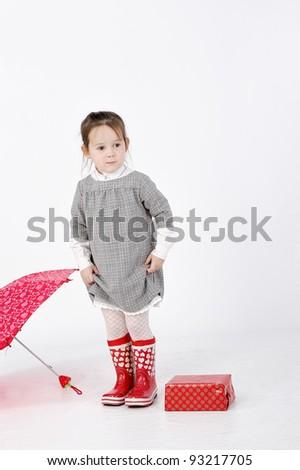 Girl standing near gift box - stock photo