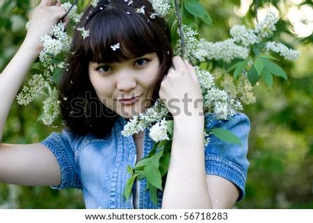 Girl standing near lilac - stock photo