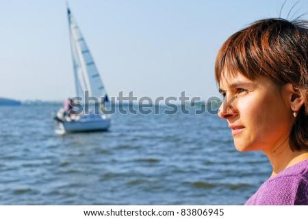 Girl standing neat lake - stock photo