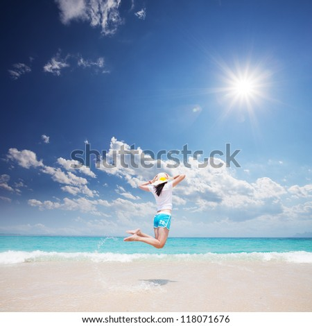 girl standing on beach - stock photo