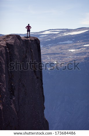 girl standing on rock in norway  - stock photo