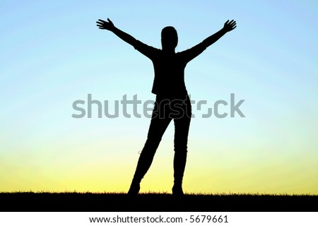 Girl standing on the sunset - stock photo