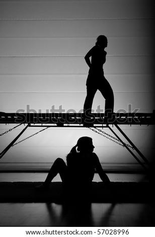 girl standing on trampoline - stock photo