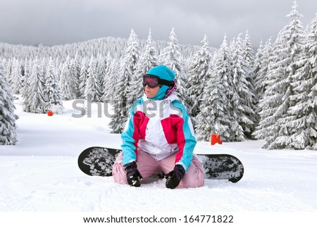 Girl standing with snowboard