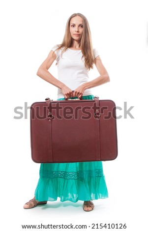 Girl standing with suitcase. Isolated over white background. - stock photo