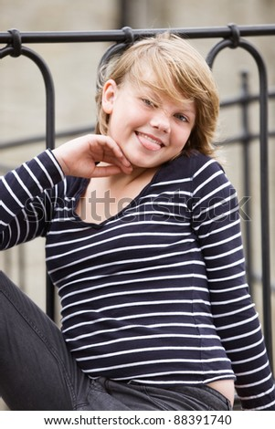 Girl sticking out tongue and smiling - stock photo