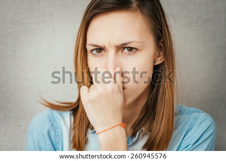 girl stinks and it closes the nose - stock photo
