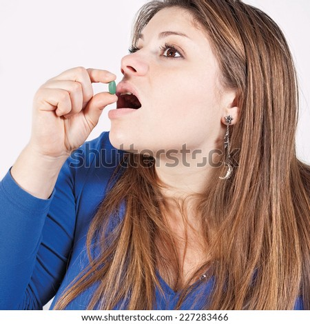 Girl struggling with a distasteful medicine