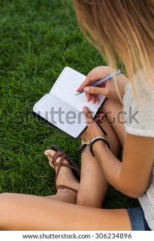 Girl studying in the park - stock photo