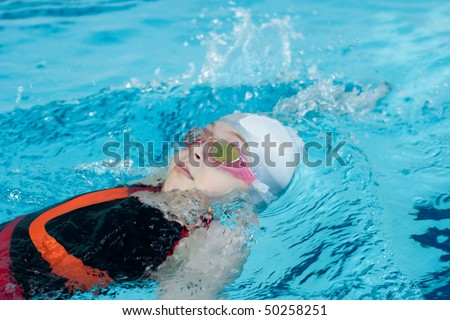 Girl swimming backstroke