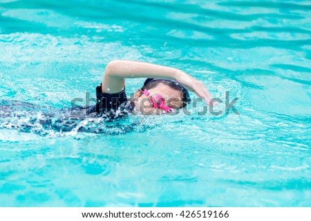 Girl swimming in the pool - stock photo