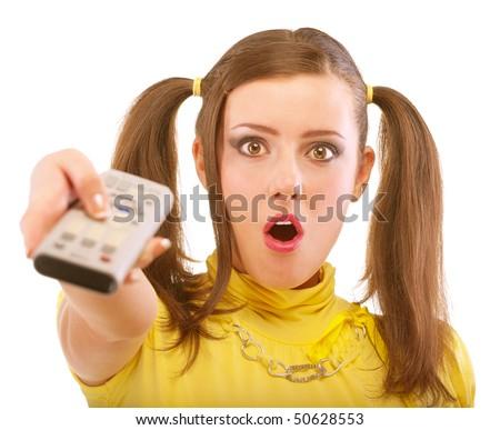 Girl switches program on TV, isolated on white background. - stock photo