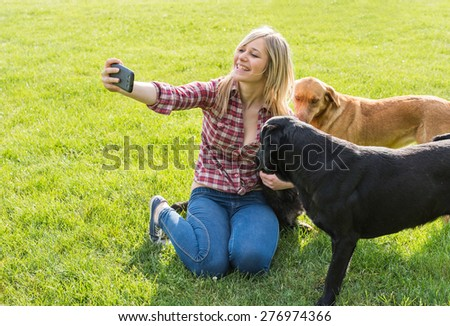 girl taking a selfie with his dog - stock photo