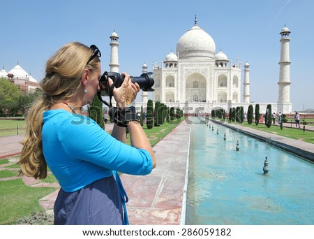 Girl taking a shot of Taj Mahal. Agra, India - stock photo