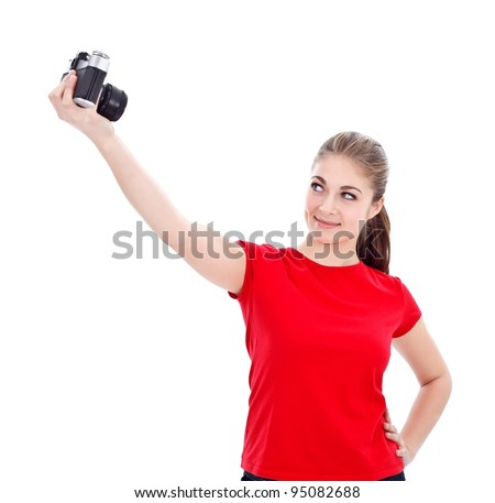 Girl taking photo of herself with an old styled camera - stock photo