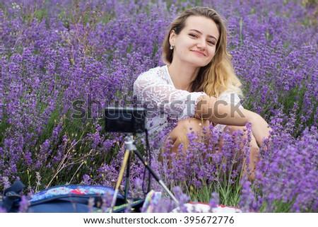 Girl taking selfie at purple lavender field - stock photo