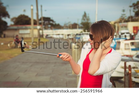 girl taking selfie picture outdoors,vintage effect - stock photo