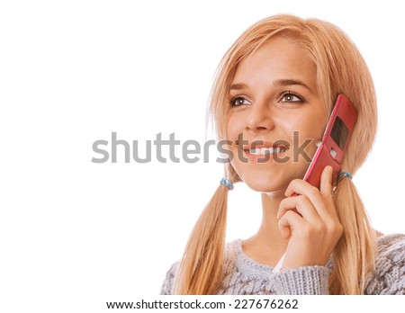 Girl talking on her cell phone and smiling, isolated on white background. - stock photo