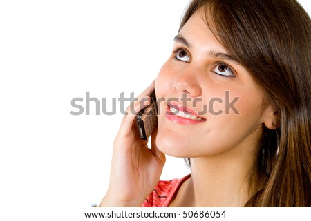 Girl talking on the phone isolated over a white background