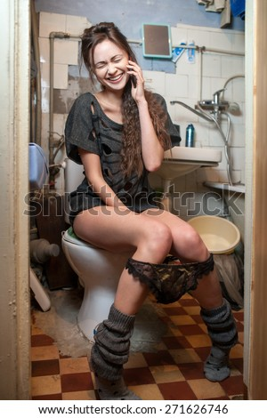 girl talking on the phone on the toilet