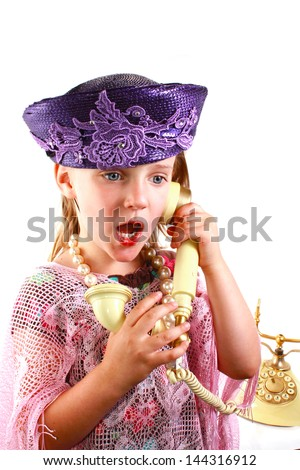Girl talks on a old fashion phone - stock photo