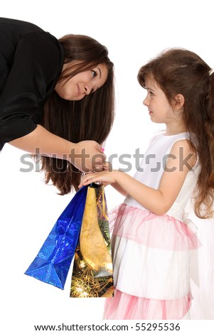 girl-teenager gives to the girl gifts, on a white background is isolated.
