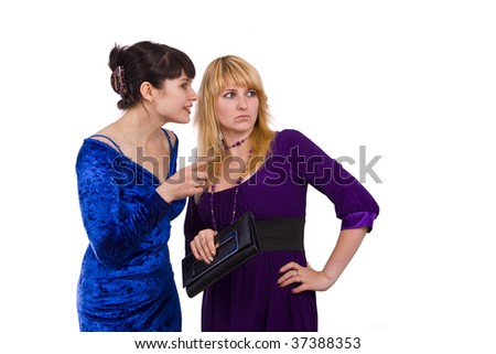 Girl telling a secret to another - gossip isolated over a white background.  Happy young women friends talking and laughing. - stock photo
