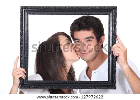 Girl tenderly kissing a man - stock photo