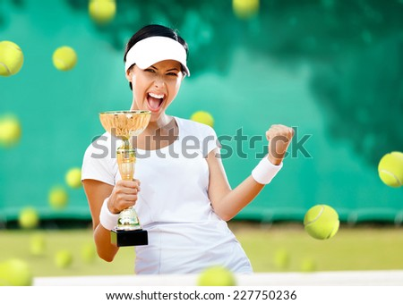 Girl tennis player won the cup at the sport competition. The joy of victory - stock photo