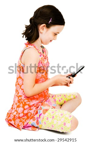 Girl text messaging on a mobile phone and smiling isolated over white - stock photo