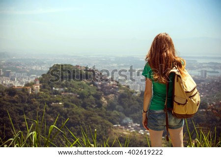 girl tourist with a backpack on the background Rio de Janeiro