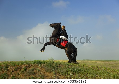 girl trains the horse - stock photo