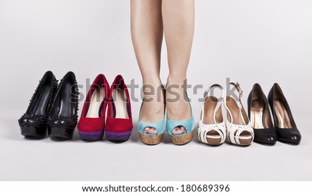 Girl trying on shoes - stock photo