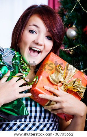 girl unpacking gifts at the Christmas tree