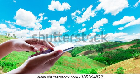 Girl use mobile phone, image of forest destruction as background. - stock photo