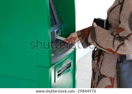 Girl uses bank terminal with credit card - stock photo