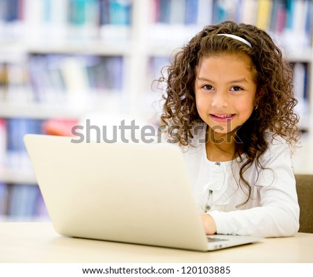 Girl using a laptop computer at school