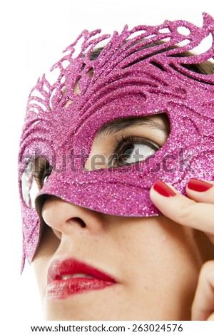 Girl using a mask to cover her face - stock photo
