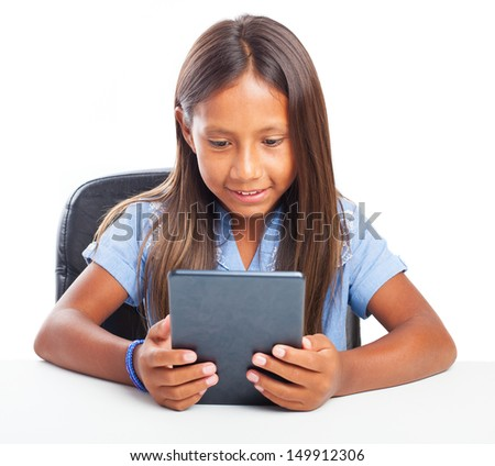 girl using a tablet on a white background - stock photo