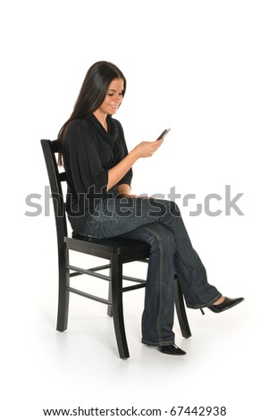 Girl using cell phone - stock photo