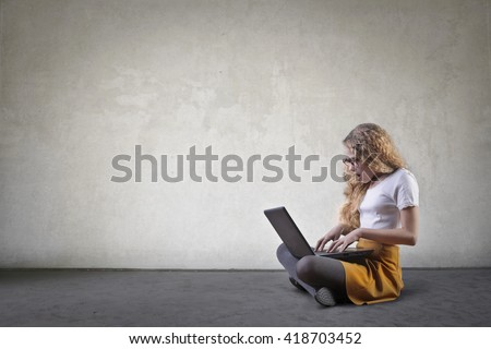 Girl using her laptop