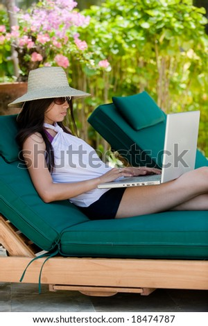 girl using laptop while having her holiday - stock photo