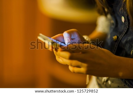 Girl using mobile smart phone - stock photo