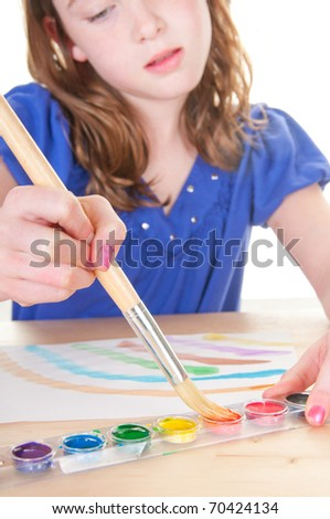 girl using paints for art