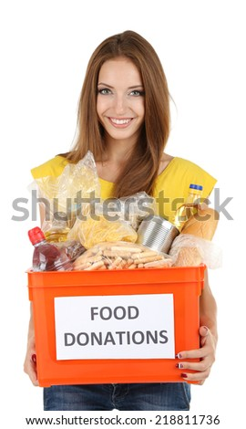 Girl volunteer with donation box with foodstuffs isolated on white - stock photo