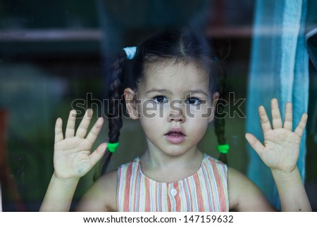 Girl waiting by the window - stock photo