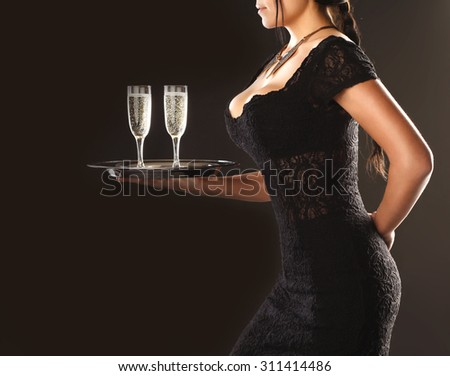 Girl waitress with a tray and glasses on a brown background - stock photo