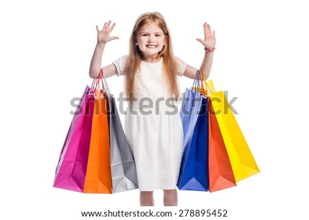 Girl waiving to camera with lots of shopping. Isolated in studio on white background. - stock photo