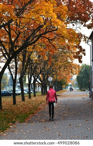 girl walk in autumn street