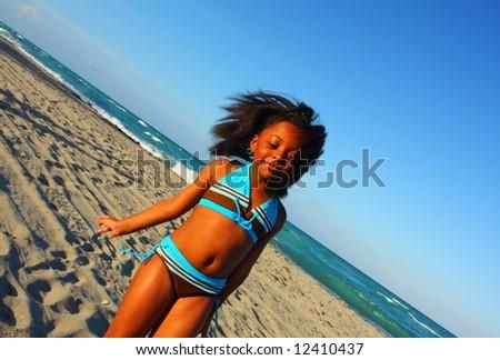 Girl walking along the sand - stock photo